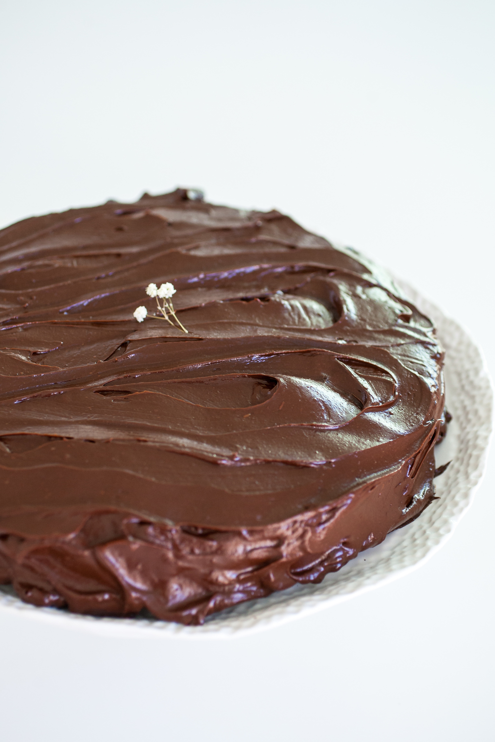 Produce On Parade - Chocolate Avocado Cake - A lightly sweetened and deliciously fudgy cake that you won?t believe is actually pretty healthy! Scrumptious avocados star in creating this dense snack cake and creamy frosting. It?s a super easy and quick cake that?s perfect for breakfast, a snack, and/or dessert!