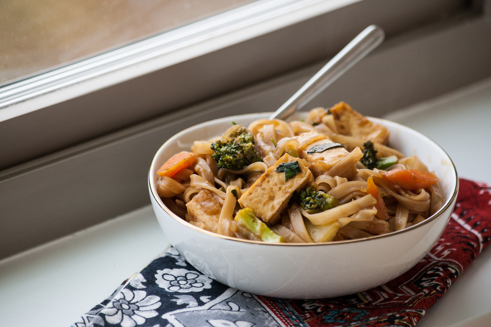 Vegan Pad See Ew - Produce On Parade - Baked tofu, and sauteed carrot and broccoli mingle with thick rice noodles; bathed in a sweet and salty Thai sauce with fresh basil. This is sure to be a family favorite.