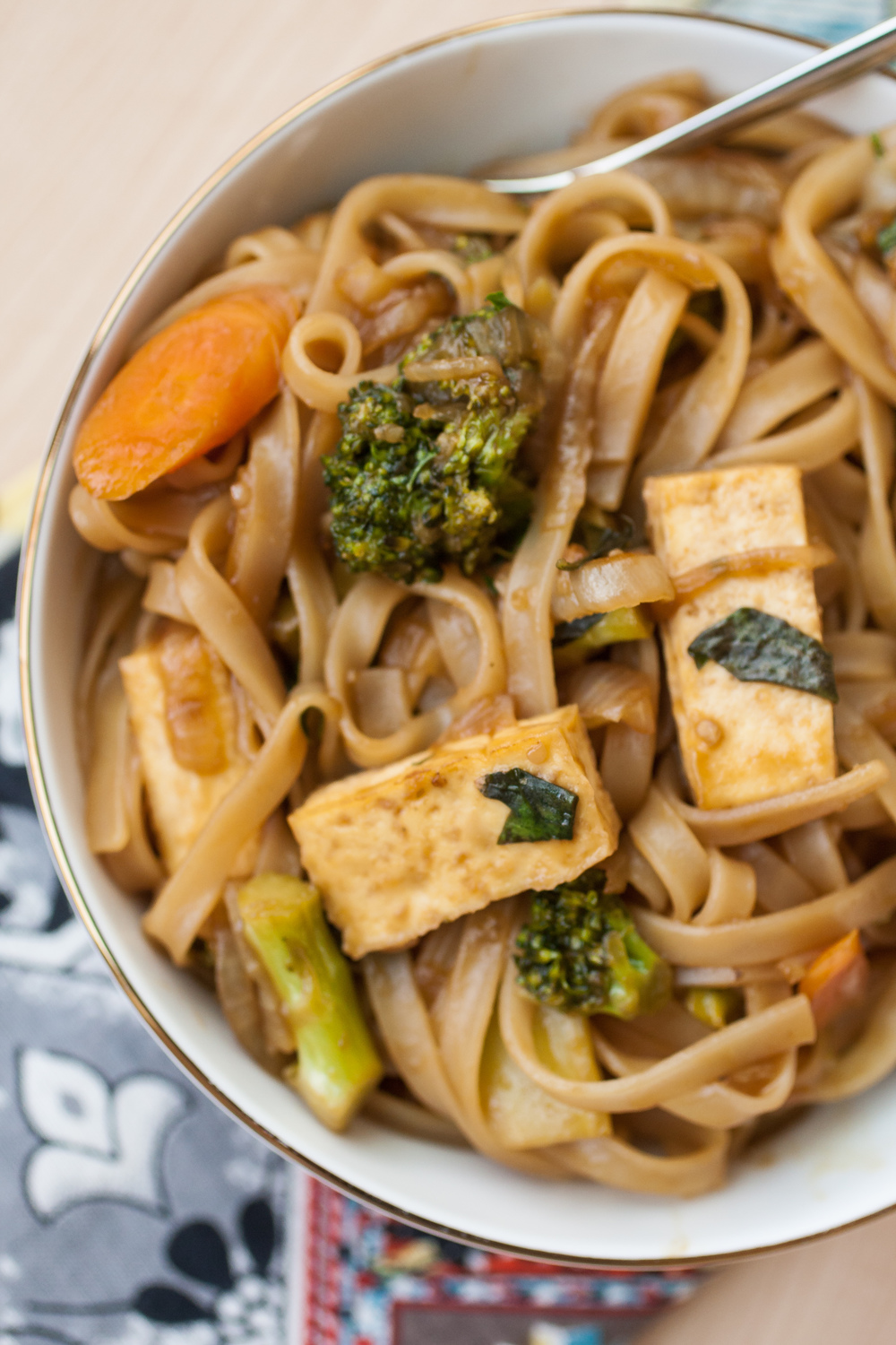 Baked tofu, and sauteed carrot and broccoli mingle with thick rice noodles; bathed in a sweet and salty Thai sauce with fresh basil. This is sure to be a family favorite.