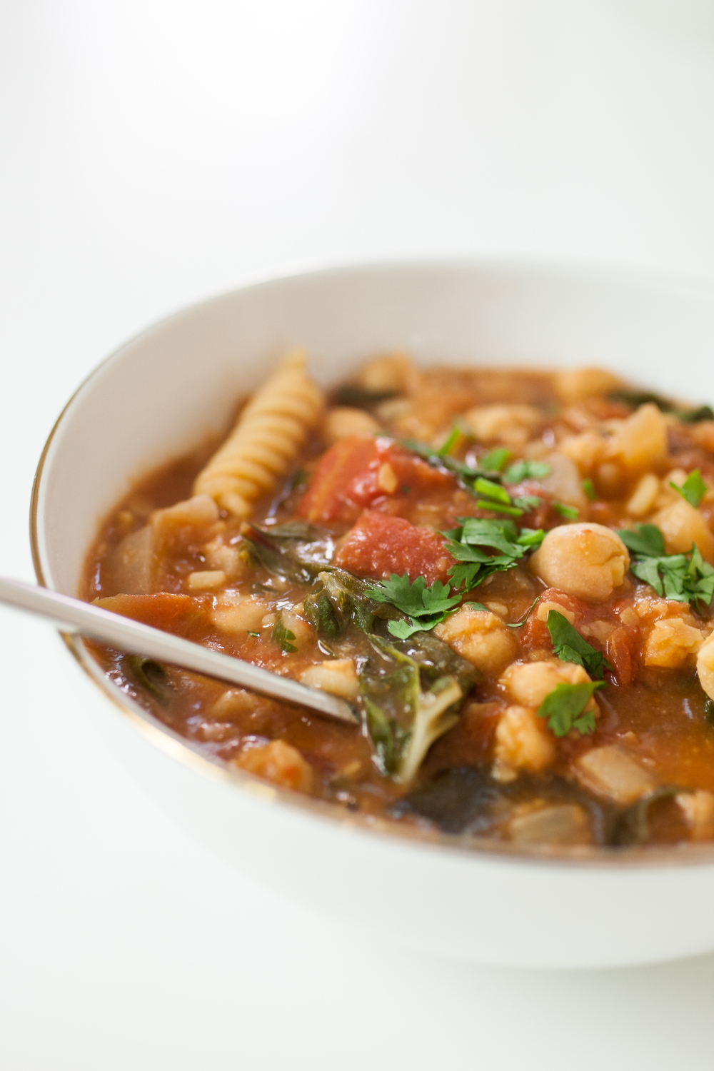 Produce On Parade - Chickpea & Chard Stew - A quick and easy flavorful stew that's as healthy as it is tasty. Full of protein and fiber, this hearty stew will fill you up and keep you satisfied. It's a staple in our house!