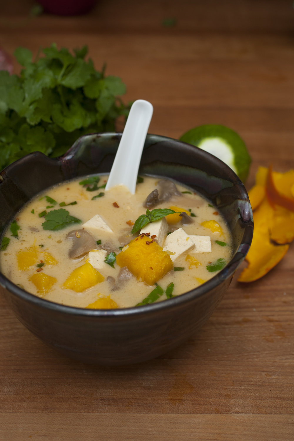 Produce On Parade- Pumpkin Tom Kha (Coconut Lemongrass Soup) - This soup is inspired by the Lao Pumpkin and Coconut Tom Kha at my favorite local restaurant, Pho Lena, in Anchorage. It's basically Tom Kha Gai without the chicken and with pumpkin instead. I add tofu for a protein boost! In Alaska, it can be difficult to find some of the very specific ingredients for Tom Kha so I've included commonplace substitutions. I have to use ginger, lime rind, and canned mushrooms because galangal, kaffir lime leaves, and straw mushrooms aren't accessible. Still, the soup is absolutely divine!