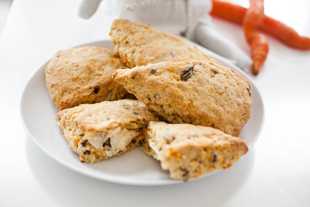 Produce On Parade - Carrot Cake Scones -  Is there anything tastier than a scone? These beauties are a wonderful marriage of sweet carrot cake and flaky  scone. Incredibly simple to make and done in a flash, they're perfect for breakfast, dessert, or a snack. Adapted from the Currant Scones from the cookbook, Vegan For Everybody.