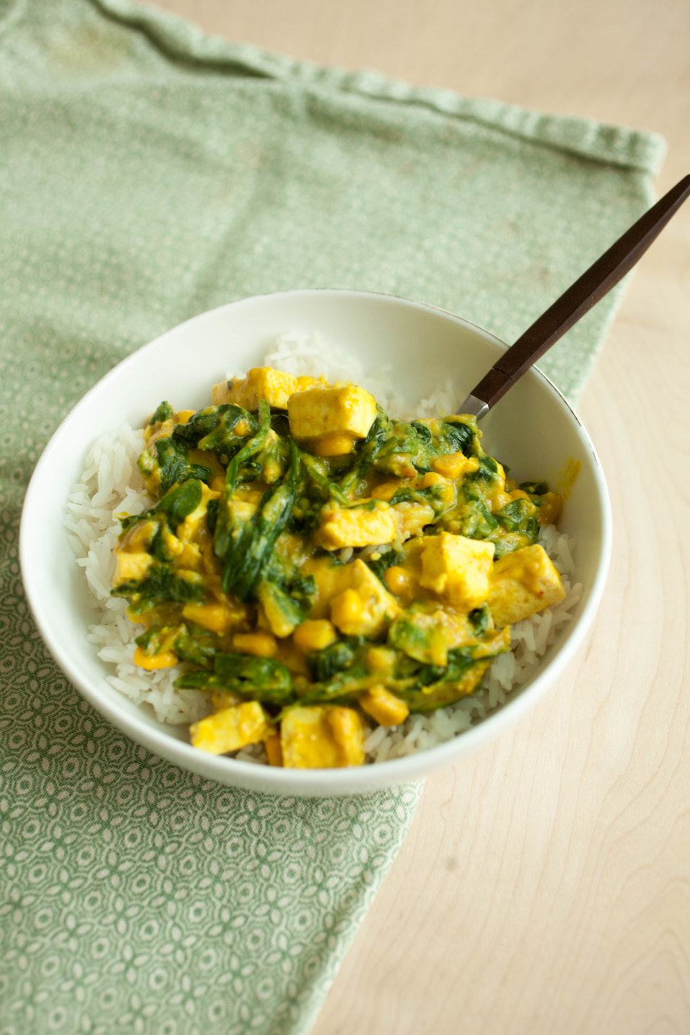 Produce On Parade - Vegan Saag Tofu Paneer - This meal is a spiced, green powerhouse with filling plant-protein. Creamy vegan saag tofu paneer is sure to please even spinach haters (at least it did in my house). It's quick and easy too; a terrific and unique weekday meal that's hearty, comforting, and satisfying. Slightly adapted from Serious Eats.