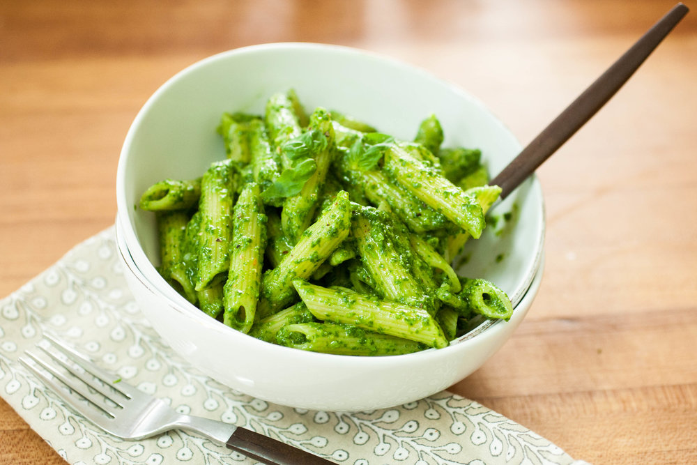 Arugula Pesto Pasta - Produce On Parade - If you have boatloads of arugula, this is a terrific way to ensure it doesn't go to waste. Arugula pesto has a little bite to it and packed with bold flavor. It whips up in the time it takes to boil the pasta, so it's a terrific weeknight meal and a wonderful way to get in some extra greens!
