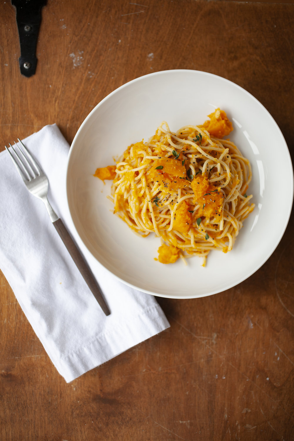 Produce On Parade - Smoked Gouda and Butternut Pasta - Sweet, roasted butternut squash coat this warm and comforting pasta while garlic and smoked gouda add a bit of richness. With so few ingredients, the stars of this dish really shine. Simple and bursting with flavor yet incredibly easy and hands off; great for a weeknight dinner. I love that this pasta is sophisticated enough for a proper dinner with company, but casual enough for a Monday meal after work. It's one of my very favorite meals.
