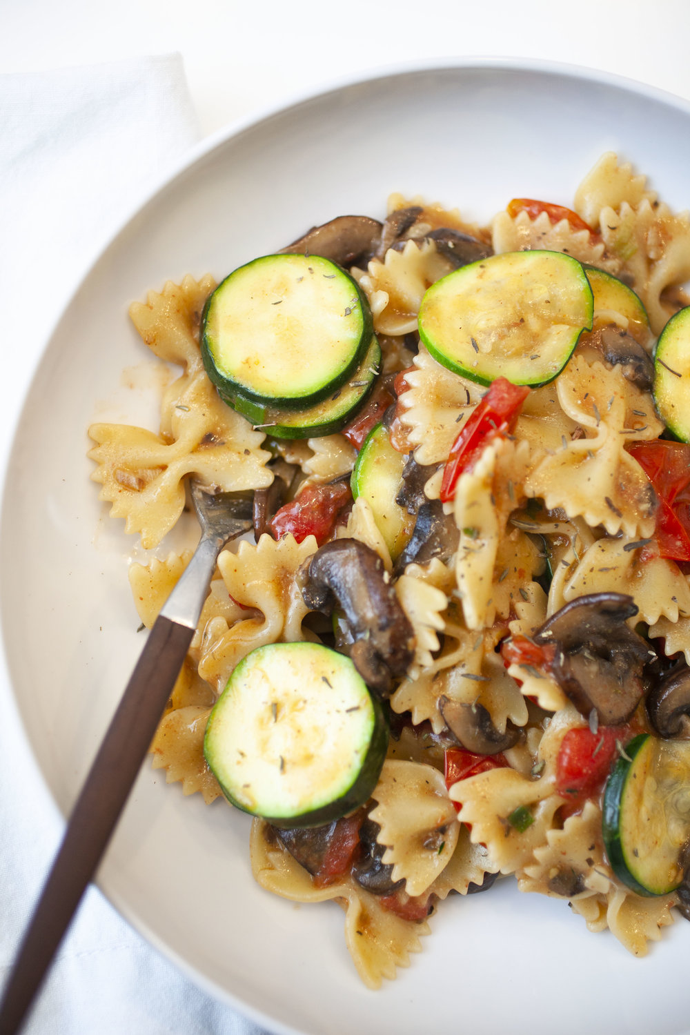 Produce On Parade - Farfalle with Zucchini, Mushrooms, and Cherry Tomatoes - I love quick and easy dinners and this veggie packed, healthy pasta dish is a wonderful weeknight meal. Another great thing: it's a terrific way to get a variety of nutritious vegetables into those picky eaters. My toddler actually picked out the zucchini to eat! I know your family will love this Farfalle with Zucchini, Mushrooms, and Cherry Tomatoes as much as we do.
