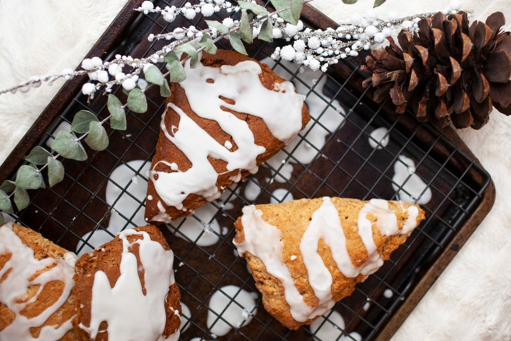 Produce On Parade - Glazed Gingerbread Scones Two Ways - Gingerbread and scones marry together festively in this scrumptiously wonderful holiday breakfast or dessert! I've included the first method that results in a dark scone that has a robust gingerbread taste and the texture is more gingerbread than scone. The second method results in a more traditional scone with that great flaky texture and a subtler gingerbread flavor.