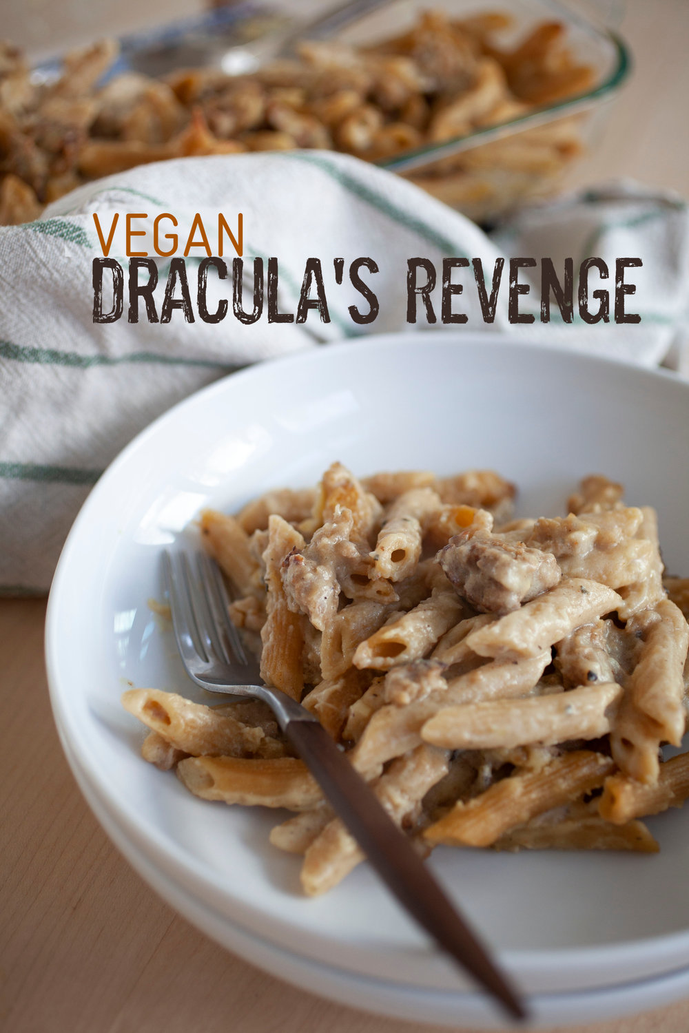 Produce On Parade - Vegan Dracula's Revenge - Delicious roasted garlic and browned vegan sausage mingle in a creamy, cheesy sauce mixed with penne pasta and baked to golden perfect. If you like garlic, cheese, and sausage this dish is going to become a staple!