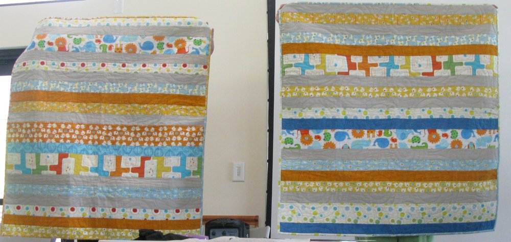 Corey Starkey showing modern baby quilts