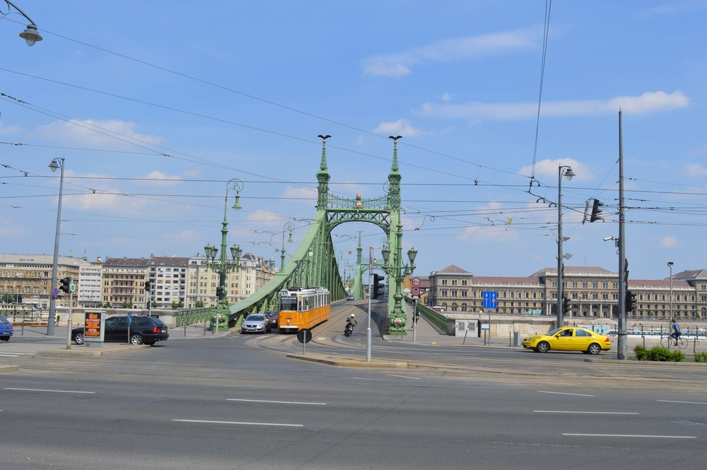 A tram on the bridge opposite Gellert.