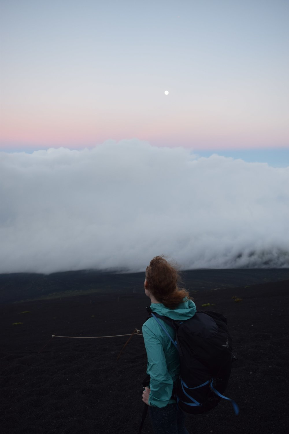 Above the clouds with the moon.