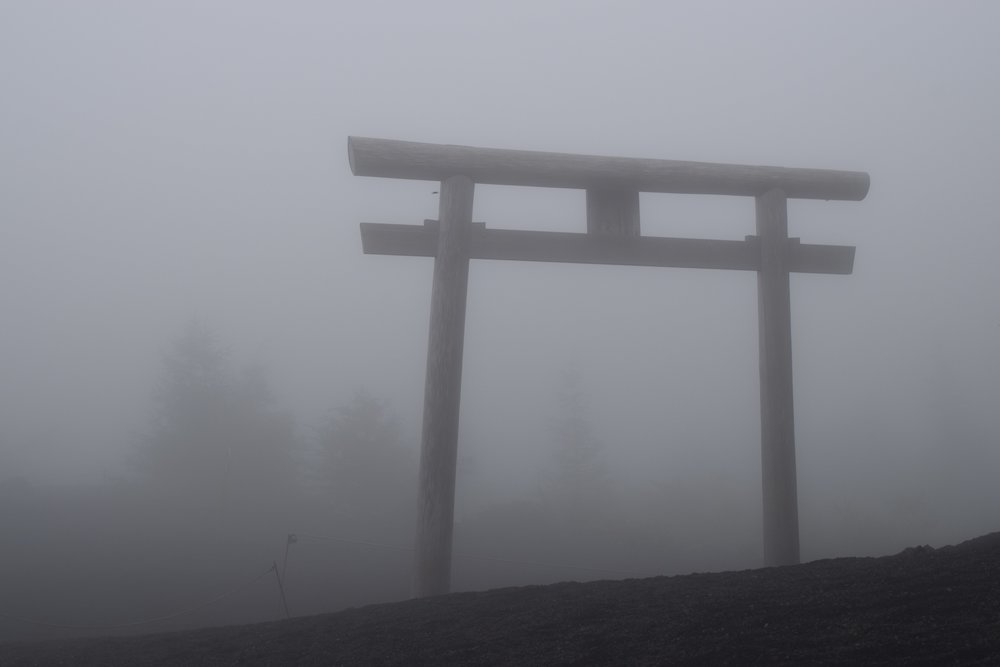 The first  torii . The next would be at the top. Luckily the clouds didn't last!