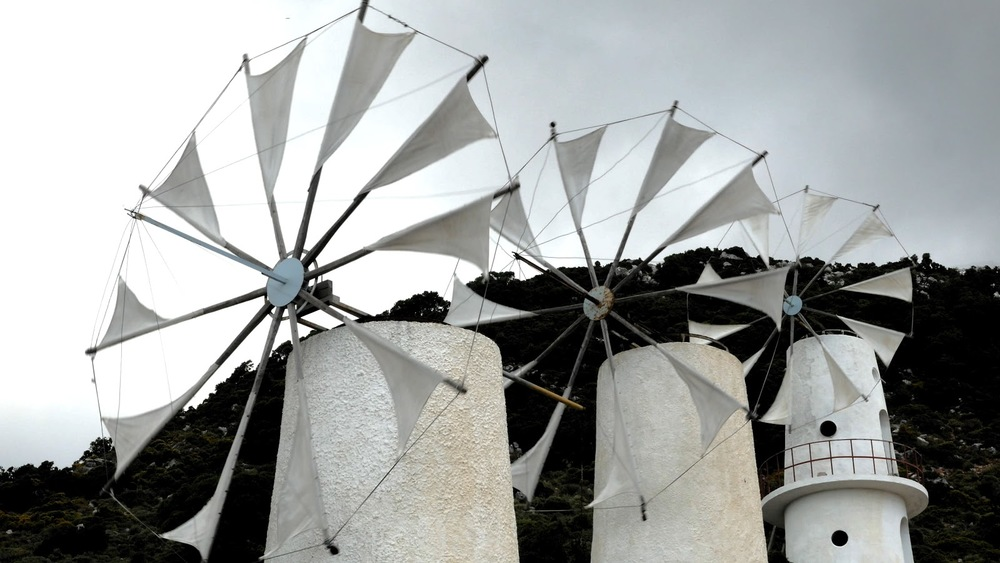 Greece Crete Lasithi Plateau Three Windmills Turning In Wind◹