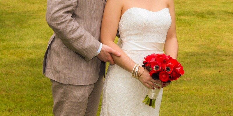 This crop from one of our wedding photos illustrates my husband's linen suit and the bouquet covering up my tummy bulge.