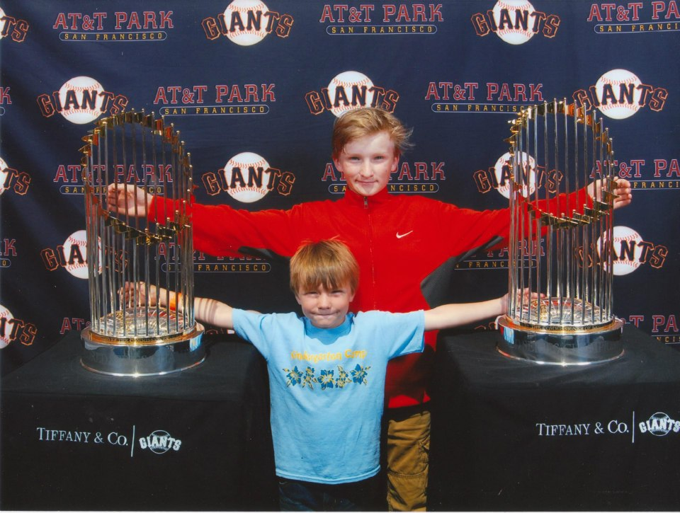 kyle and Gavin Nelson with The World Series Trophies