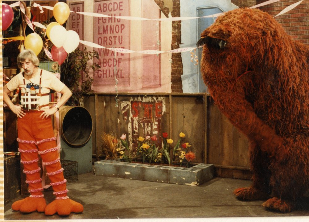 Archival photo of Caroll Spinney and Snuffleupagus on the set of Sesame Street. Photo courtesy of Debra Spinney.