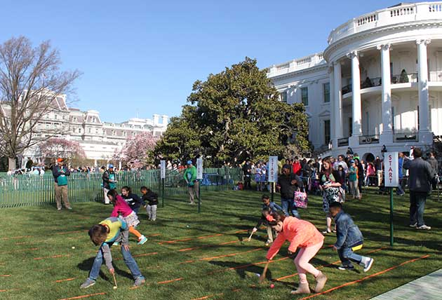 Children race each other while pushing eggs with wooden spoons at the White House Easter Egg Roll event. (NPS)