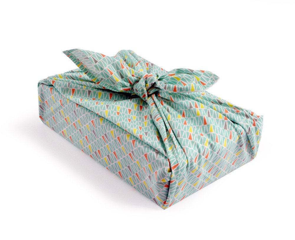 Reuse Gift Wrapping Paper or Gift Bag - Gift wrap is a big waste problem. You can reduce that problem in many different ways. Try Furoshiki, the Japanese tradition of wrapping gifts in colorful swaths of fabric. It's an elegant way to avoid using plastic or paper bags and help to preserve natural resources. Check YouTube for quick and easy how-to videos.