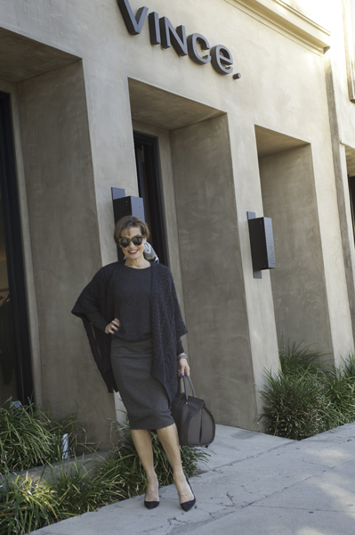 Vince Poncho ,  Vince Sweater ,  CAbi Skirt ,  Manolo Blahnik Pumps ,  Balenciaga Bag , Pucci Scarf,  Karen Walker Sunglasses .