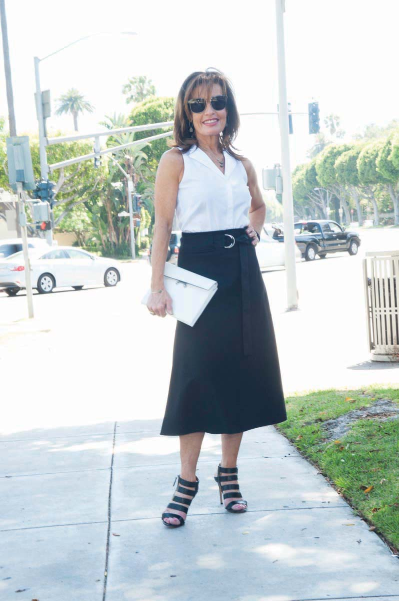 Celine Skirt, Worth New York Blouse and Clutch, Gianvito Rossi Heels, Oliver Peoples Glasses, Robin Terman Necklace, Earrings and Bracelets.