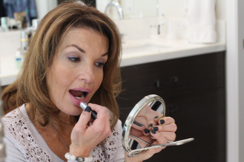 "A retro mod pink lipstick completes the look. (MAC, ""Snob"" Lipstick)"