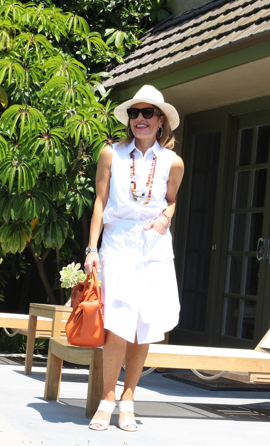 Top and Skirt T by Alexander Wang, Stuart Weitzman Sandals, CAbi Hat, Celine Sunglasses. Diane Cotton Beads and Celine Handbag both available at Savannah Santa Monica. John Hardy Bracelets and Hoops, also seen here.