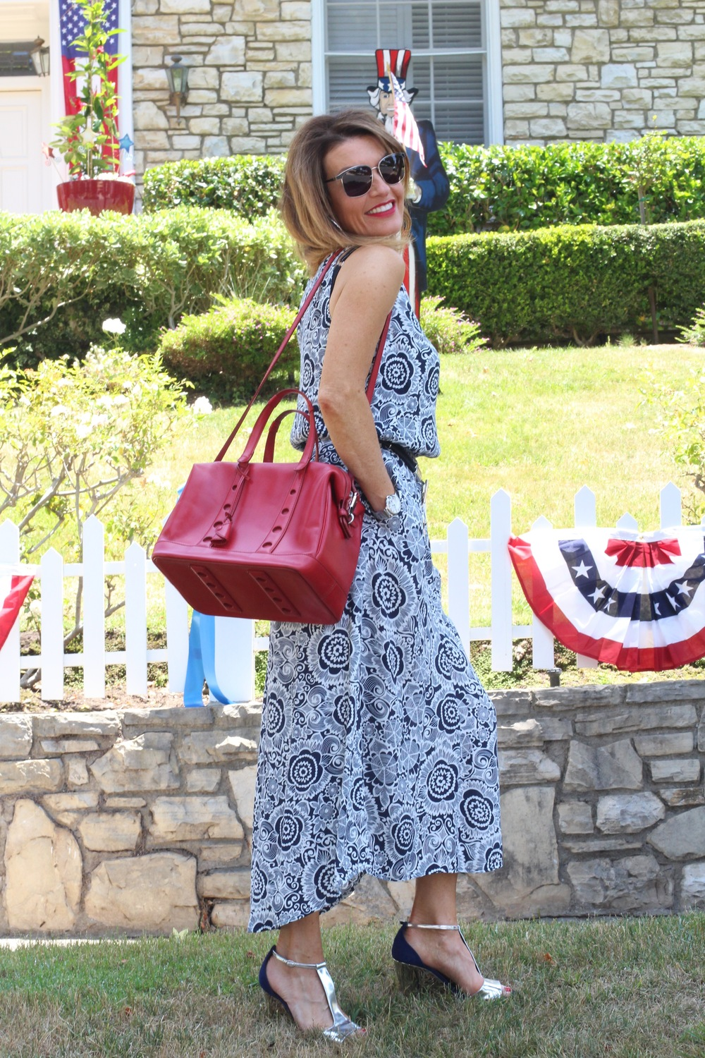 CAbi Twirl Dress, Worth New York Belt, Myriam Schafer Handbag, Rupert Sanderson Sandals, on sale here, John Hardy Earrings and Bracelets, Cartier Watch, Oliver Peoples Sunglasses, Mac Ruby Woo Lip Color, Essie Really Red Nail Polish.