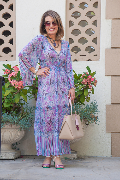 Calypso St. Barth Caftan and Slip, Sandro Sandals, on sale here, Christian Dior Tote (also seen here), Oliver Peoples Glasses, Nancy Newberg Earrings, Robin Terman Necklace and Ring, Nest Bracelets.