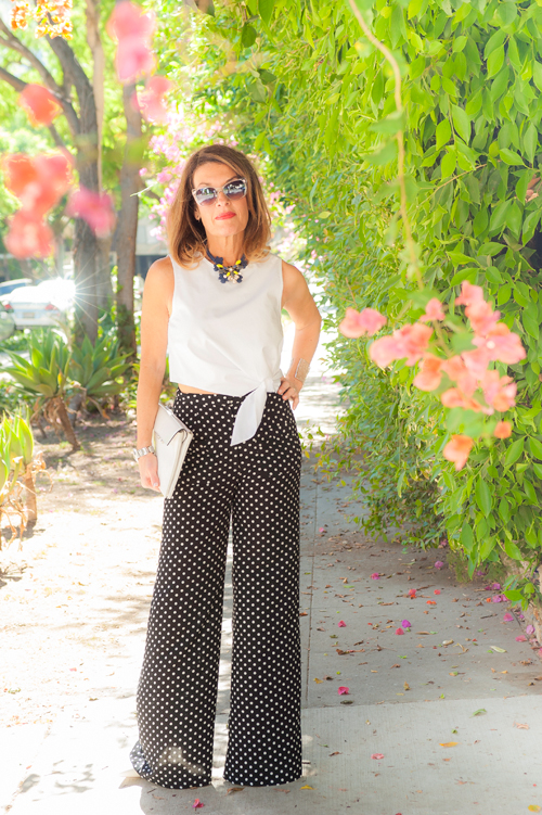 LF Palazzo Pants ($30), similar  on sale here ,  Tibi Crop Top , Think Closet Necklace ($20!)--  similar on sale here , Fendi Heels, also seen here, Nest Cuff, Christian Dior Shades, Worth New York Clutch.