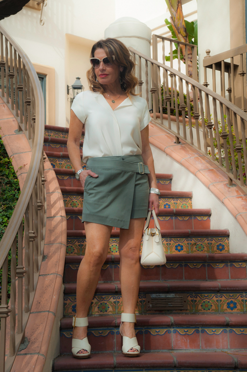 Peter Cohn Blouse, Worth New York Skort, Bally Sandals and Handbag, Oliver Peoples Sunglasses, Chanel Bracelet, Stephanie Kantis Earrings.