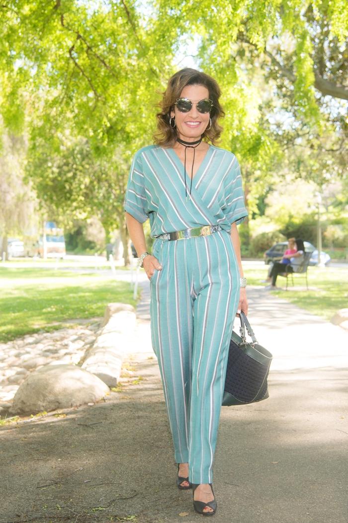 Maje jumpsuit (   similar here   ) ,    B-low The Belt belt   , Gianvanito Rossi heels (   similar here   ), Caroline Di Marchi handbag (   similar here   ),    Miu Miu sunglasses   ,    Robin Terman tie choker   ,    John Hardy earrings.