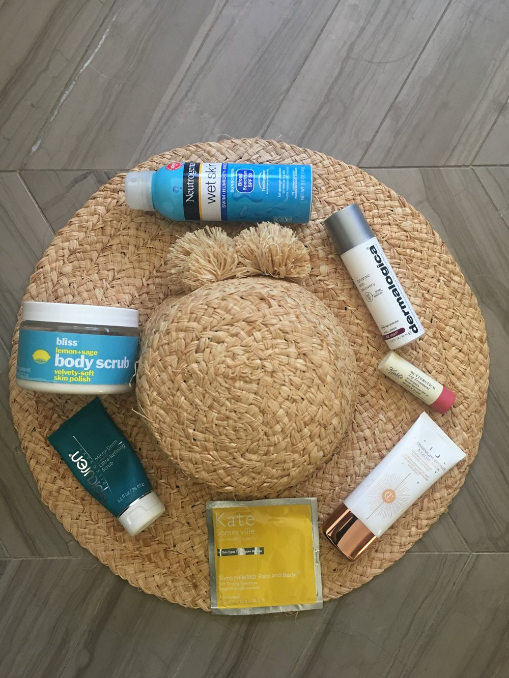 Kate Somerville Tan Towelettes   ,    Epicuren Micro Derm Scrub   ,    Bliss Body Scrub, similar here   ,    Neutrogena Wet Skin  Sunscreen   ,    Dermalogica Dynamic Skin Recovery SPF 50   ,    Kiehl's Butterstick Lip Treatment SPF 25   ,    Charlotte Tilbury Overnight Bronze and Glow Mask   .