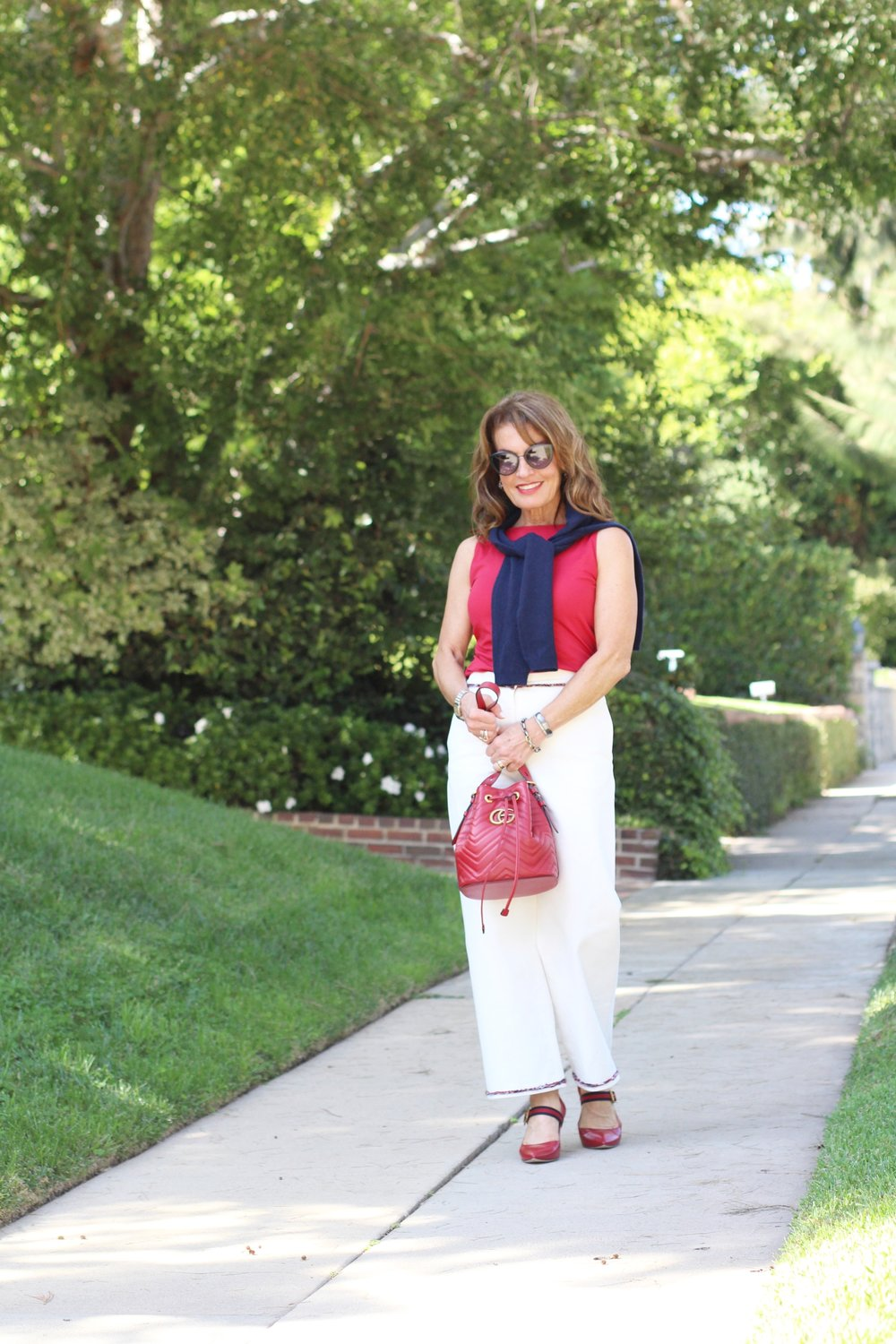 Chanel pants,    Worth New York top   ,    C by Bloomingdales cardigan   , Gucci shoes and handbag,    Suneera bracelets   , Chanel shades.
