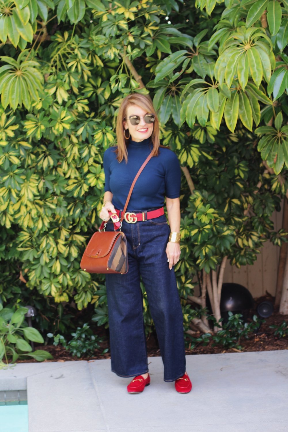 I love a strap that can be worn cross body.    Fendi vintage handbag similar here