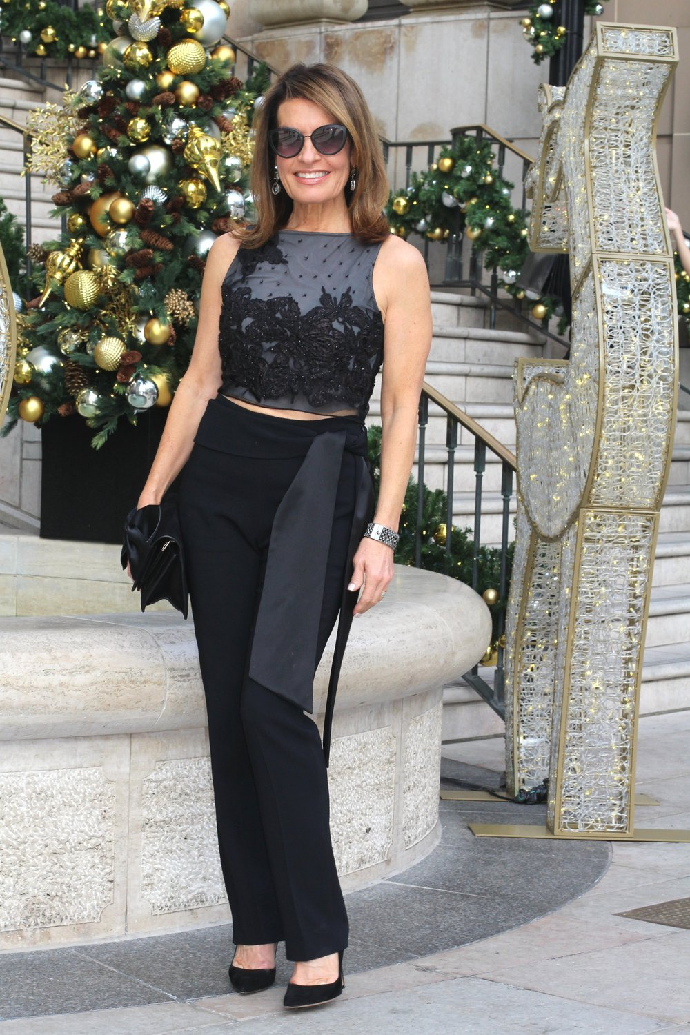 Tibi top    similar here   , Givenchy pants    similar here,    Victoria Beckham clutch    similar here,       Gianvito Rossi pumps   , Chanel cuff and shades,    Swarovski earrings