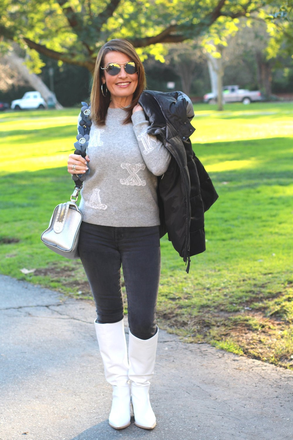 Max Mara sweater   , J Brand jeans, Gianvito Rossi boots,    similar for less here     ,   Brunello Cucinelli Jacket,     similar and on sale here     ,   Fendi handbag and strap, Miu Miu Sunnies,    John Hardy earrings   , Spinelli Kilcollin ring.