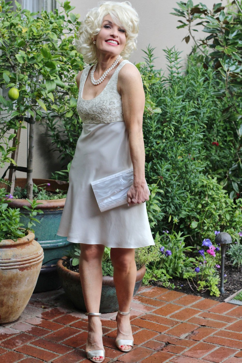 Vintage Caché dress,    similar here        and    here   . Manolo Blahnik heels    similar here     ,   vintage clutch.