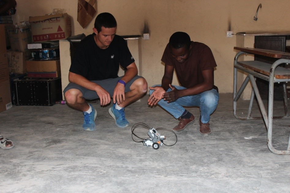 Training teachers to use the robotics equipment donated by Emmanuel.