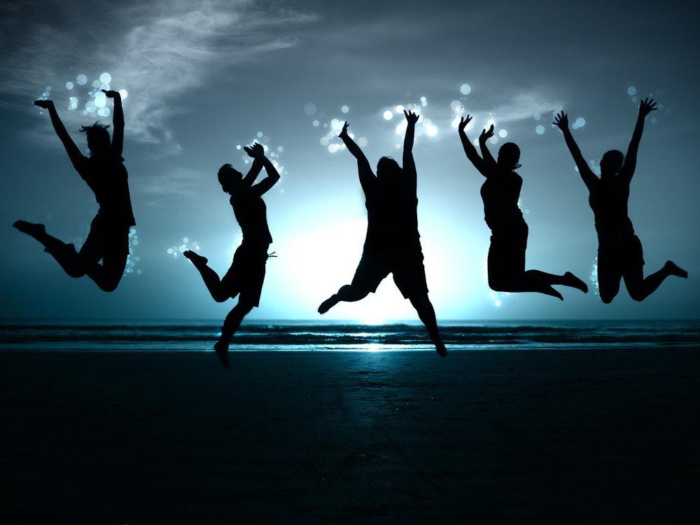 Women jumping on beach.jpg