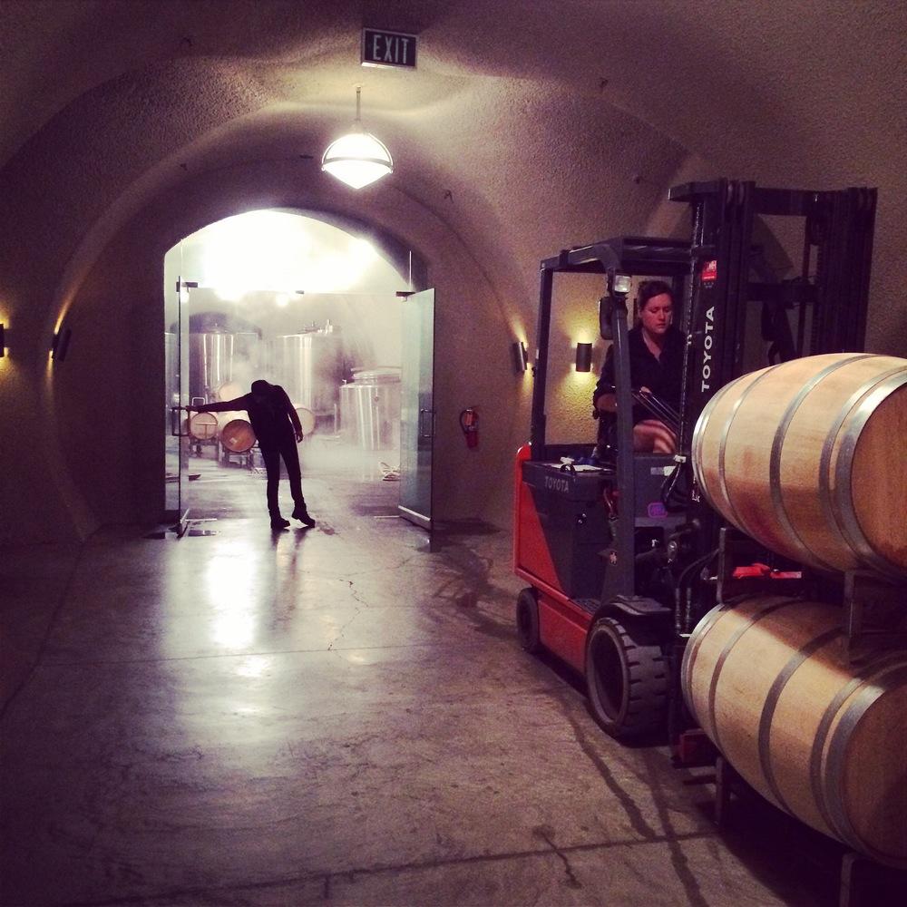 Cellar workers sanitize barrels before harvest begins