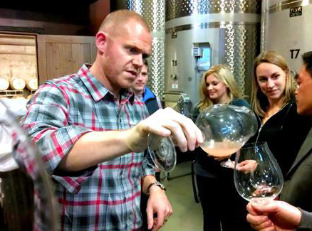 A.J. pouring his white Pinot at their winery in Oregon