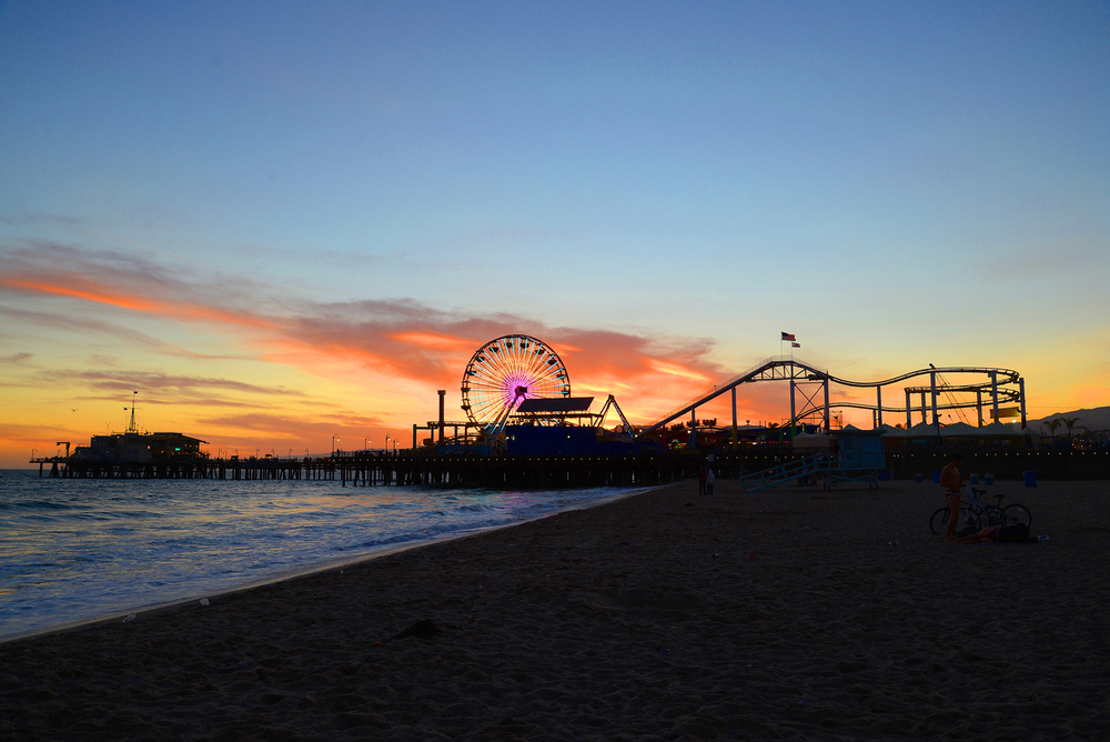 The Sunset creates a silhouette of the pier , closing a chapter on a summer day