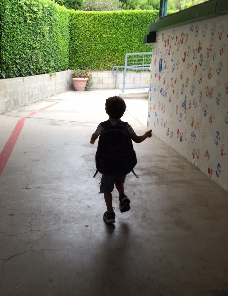 My son running to hisclassroom the next morning, on his first day of Transitional Kindergarten