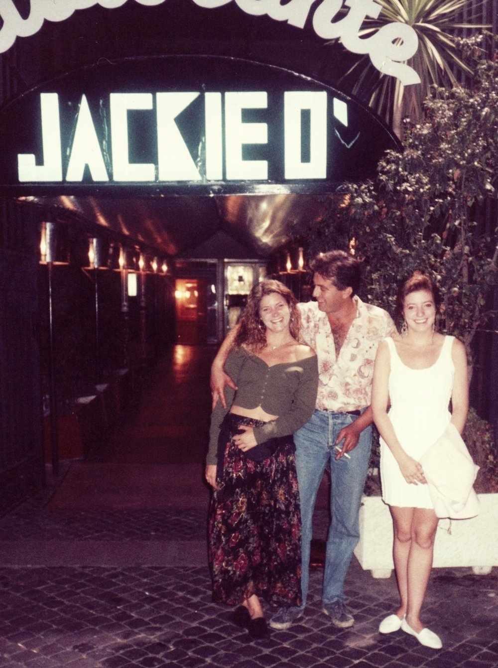 My sister and I with an admirer at the Jackie O' Ristorante, Roma, Italia - August 1990