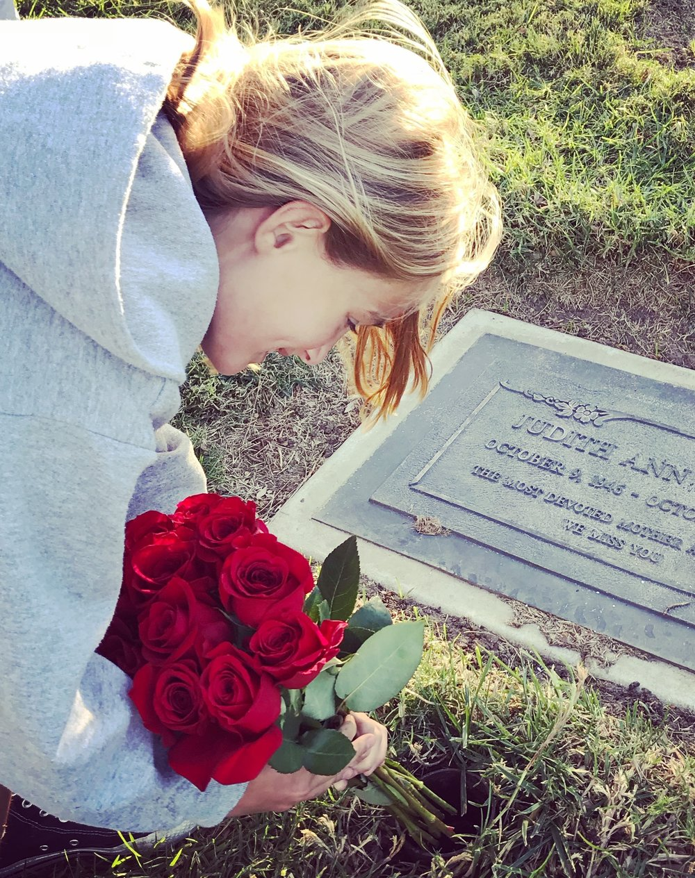 My daughter leaving flowers for her grandmother on her birthday yesterday - Now ten years old, she was born three months after my mom died.