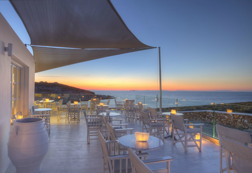 Luxury Hotel Paros Minois Village Deck Lounge at sunset.jpg