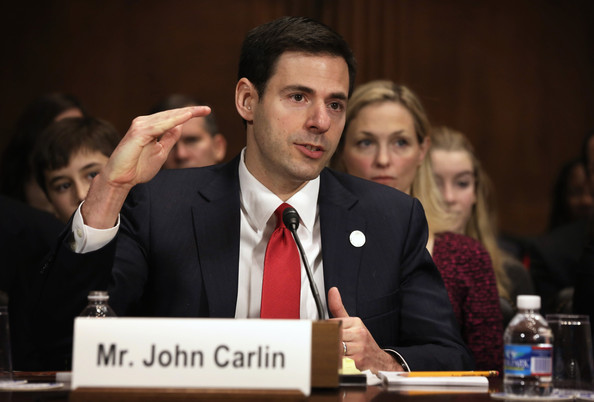 John Carlin testifies before the Senate Judiciary Committee.