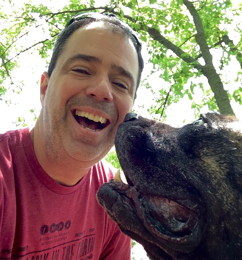 Scott getting a little pet therapy from his favorite rescue mastiff. 520 University AVE, Suite 150 / Madison, WI  53718 / 608-628-3963 / scott@fullbeingness.com
