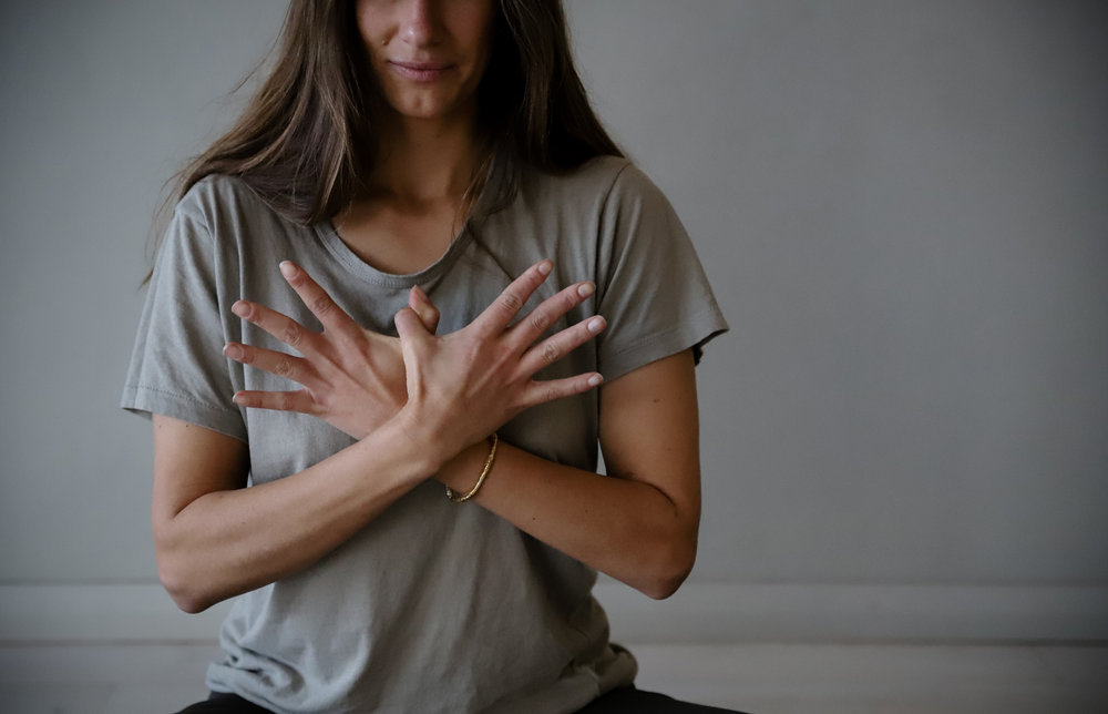 Garuda Mudra - Balances the air element in the body. The hook of the thumbs and fanning of the fingers balances vata dosha in both sides of the body. When the air element is imbalanced, it is common to feel stuck and stifled, or completely scattered. The mudra works in the way that it brings in 'fresh air' if you need it OR re-centres the dispersion of air if you feel frenetic or scattered. Balanced vata should have you feeling energised and inspired