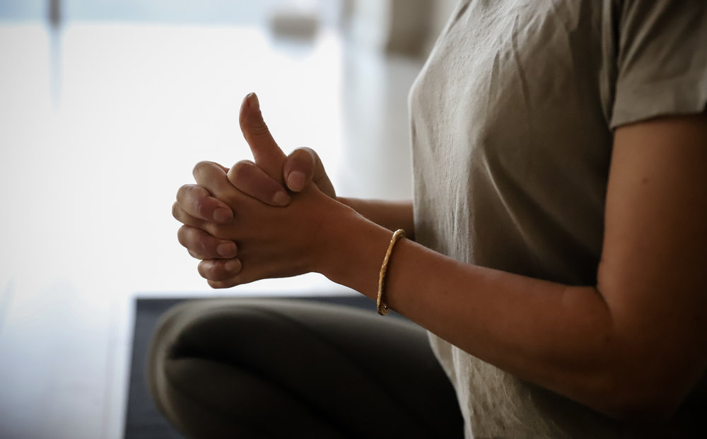 Linga Mudra - The thumb represents the element of fire, and here it is activated with strength. When we stimulate the element of fire, it is to burn through mental and physical fatigue. Linga comes from the root sound lin meaning to dissolve. With the right thumb extended, this is an energising and heating mudra that brings the necessary element of fire to shift out complacency, sleepiness, lethargy to open up space for new, fresh, positive energy.